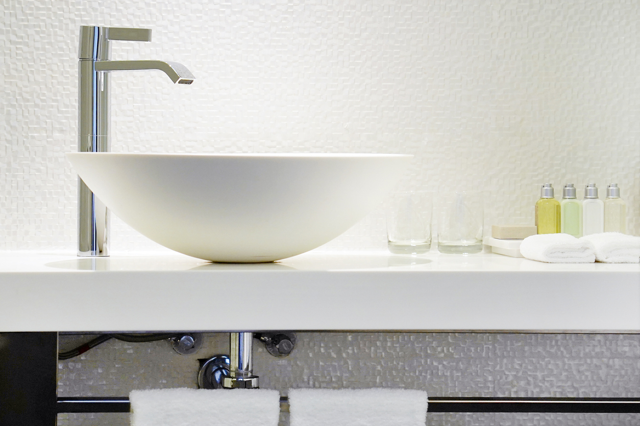 Modern white bathroom with mixer tap