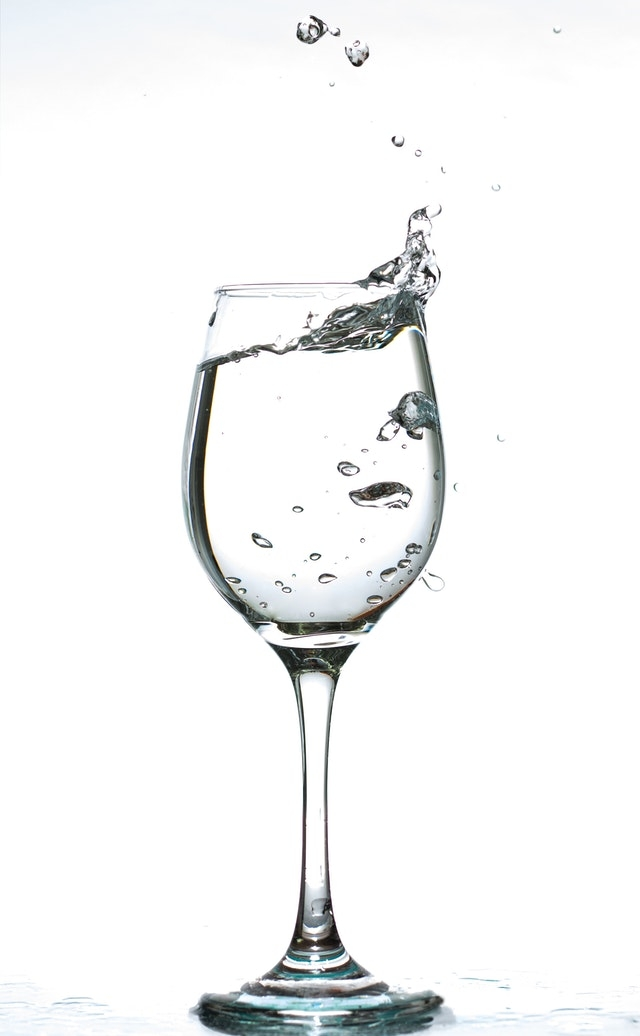 Clear water in wine glass